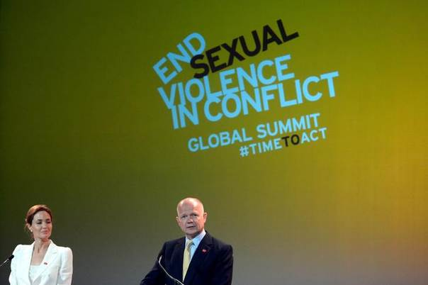 Actress and special envoy of the UN High Commissioner for Refugees (UNHCR), Angelina Jolie, and British Foreign Secretary William Hague make their opening speeches at a global summit to end sexual violence in conflict, in London June 10, 2014. REUTERS/Carl Court/pool