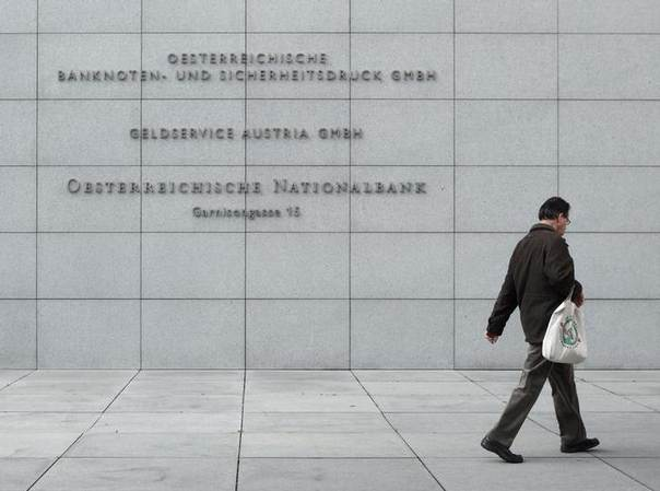 In this 2011 file photo, a man passes the headquarters of Oesterreichische Banknoten- und Sicherheitsdruck Gmbh (OeBS), a company of Austria's central bank OeNB printing Euro banknotes in Vienna REUTERS/Heinz-Peter Bader