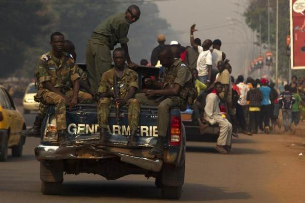 Gendamerie escort a funeral procession of a man who was killed several days ago in the Central African Republic capital Bangui, Central African Republic, January 15, 2014. REUTERS/Siegfried Modola