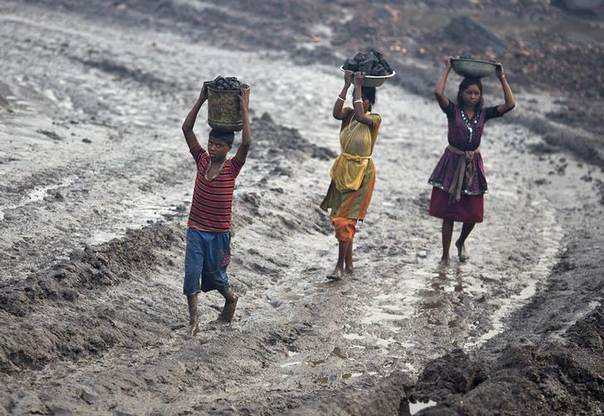 In this 2012 file photo, locals carry coal from an open cast coal field at Dhanbad district in the eastern Indian state of Jharkhand REUTERS/Ahmad Masood