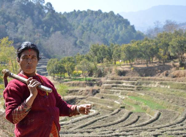 A farmer talks about rainfall variability near her fields in Panityanki, a picturesque mountain village in Nepal's Kavrepalanchowk district, about 35 kilometers from Kathmandu. ALERTNET/Saleem Shaikh