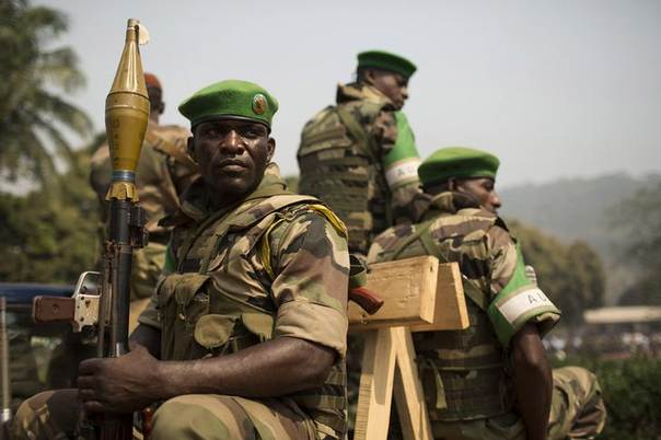 Soldiers from the African Union peacekeeping mission (MISCA) prepare to leave in a convoy at the end of a speech given by Alexandre-Ferdinand Nguendet, the head of Central African Republic's (CAR) transitional assembly (CNT), at the Gendarmerie headquarters in Bangui, Central African Republic, on January 13, 2014. REUTERS/Siegfried Modola