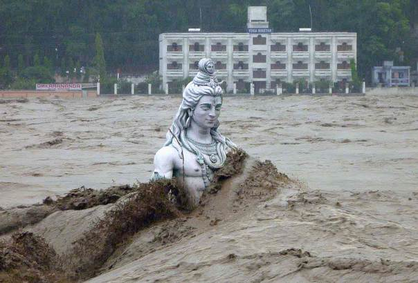 A submerged statue of the Hindu Lord Shiva stands amid the flooded waters of the river Ganges at Rishikesh in the Himalayan state of Uttarakhand, India, on June 17, 2013. REUTERS/Stringer