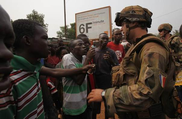 Angry young men complain to French soldiers in patrol in the pro-Christian area of Bangui February 15, 2014 REUTERS/Luc Gnago