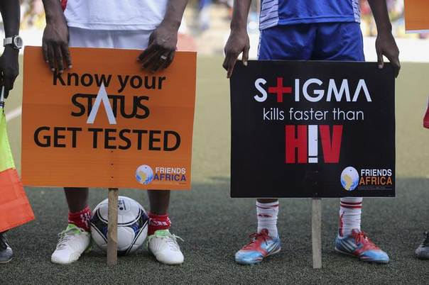 Banners for AIDS awareness are held by soccer players during a charity match for World AIDS Day in Lagos, Nigeria, November 30, 2013. REUTERS/Akintunde Akinleye