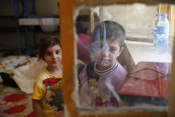 Children of a Christian family, who fled from the violence in Mosul two days ago, stay at a school in Arbil, in Iraq's Kurdistan region June 27, 2014. REUTERS/Ahmed Jadallah