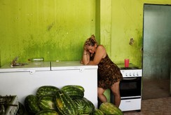 A Venezuelan woman stands in a kitchen of a gym which has turned into a shelter for Venezuelans in Boa Vista, Brazil