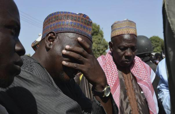 A man weeps as he joins parents of kidnapped school girls during a meeting with the Borno State governor in Chibok, Maiduguri, Borno State April 22, 2014. REUTERS/Stringer