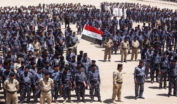 Volunteers, who have joined the Iraqi security forces to fight against the predominantly Sunni militants from the radical Islamic State of Iraq and the Levant (ISIL), wearing the police force uniforms gather in the holy city of Najaf, June 18, 2014 REUTERS/Alaa Al-Marjani