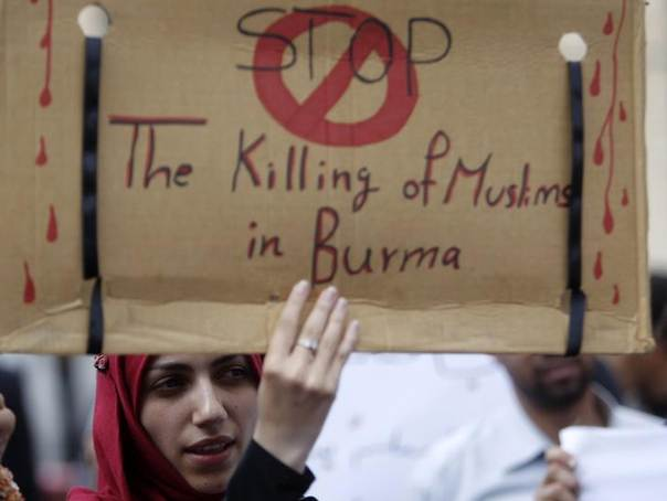 A woman carries a sign during a demonstration against the massacre of the Rohingya Muslims of Myanmar, formerly known as Burma, outside the United Nations' offices in Sanaa, August 13, 2012. REUTERS/Khaled Abdullah
