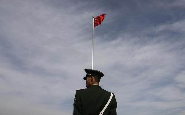 In this 2011 file photo, a paramilitary policeman stands guard at Tiananmen Square in Beijing REUTERS/Jason Lee