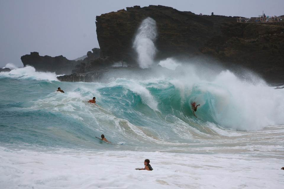 Bodysurfers And Boogie Boarders Catch Waves At Sandy Beach On The East Side Of Oahu As Tropical Storm Iselle Passes Through Hawaiian Islands