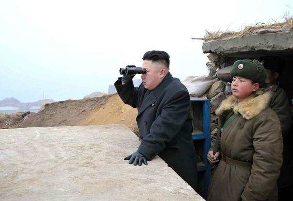 North Korean leader Kim Jong-Un (C) uses a pair of binoculars to look towards the South during his visit to the Jangjae Islet Defence Detachment and Mu Islet Hero Defence Detachment on the front, near the border with South Korea, southwest of Pyongyang, March 7, 2013, in this picture released by the North's official KCNA news agency in Pyongyang March 8, 2013. REUTERS/KCNA