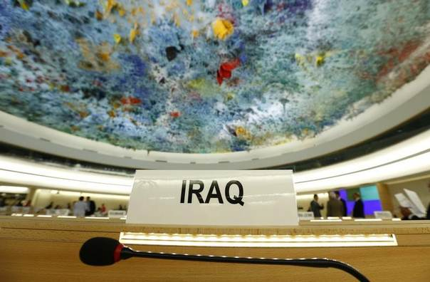 The country name of Iraq is pictured on a desk before a special session of the Human Rights Council on Iraq at the United Nations Europeans headquarters in Geneva September 1, 2014. REUTERS/Denis Balibouse