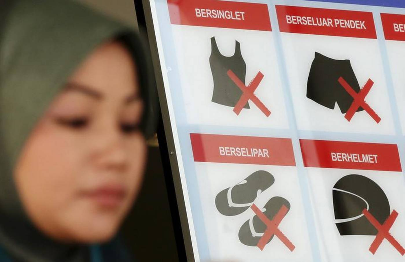 Malaysia probes book on Muslim women who refuse to wear headscarves