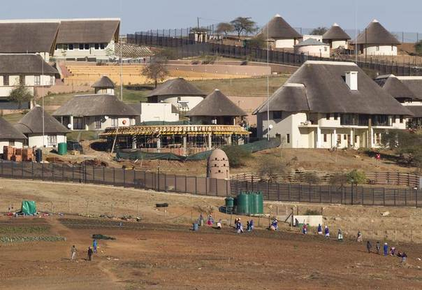 A general view of the Nkandla home (behind the huts) of South Africa's President Jacob Zuma in Nkandla. Picture taken August 2, 2012. REUTERS/Rogan Ward