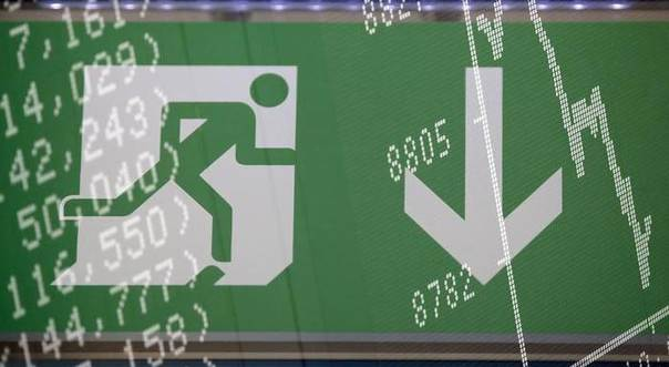 A multiple exposure photo of an emergency exit sign and a detail of the current German share price index curve at the stock exchange in Frankfurt, Oct. 17, 2013. REUTERS/Kai Pfaffenbach