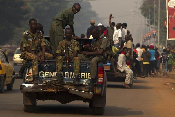 Gendamerie escort a funeral procession of a man who was killed several days ago in the Central African Republic capital Bangui January 15, 2014. REUTERS/Siegfried Modola