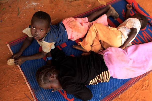 Displaced children from Abu Kershola, South Kordofan state, rest at a school in Al-Rahaad in North Kordofan state, on May 28, 2013. REUTERS/Mohamed Nureldin Abdallah