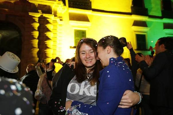 People celebrate after parliamentarians voted to recognise same-sex partnerships in the square outside parliament in Valletta, Malta, April 14, 2014. REUTERS/Darrin Zammit Lupi