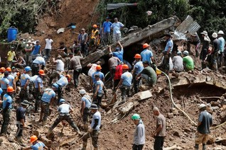 Praying for miracles, rescuers seek signs of life after Philippine typhoon landslides