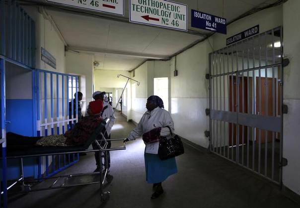 A patient is wheeled on a stretcher next to an isolation ward (R) set aside for Ebola related cases at the Kenyatta National Hospital (KNH) in the capital Nairobi. Picture August 19, 2014, REUTERS/Noor Khamis
