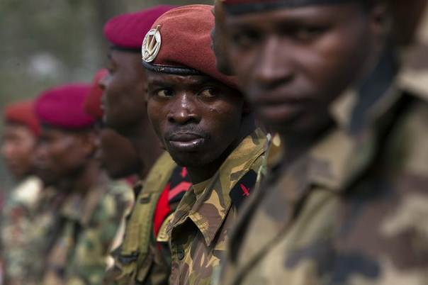 Central African Army Forces (FACA) soldiers gather during a speech by interim president of the Central African Republic Catherine Samba-Panza (not pictured) at the National College of Administration and Magistrature in the capital Bangui February 5, 2014.  REUTERS/Siegfried Modola