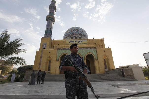 This photo from 2013 shows a policeman standing guard at a Sunni mosque during Eid al-Adha celebrations in Baghdad. REUTERS/Thaier Al-Sudani