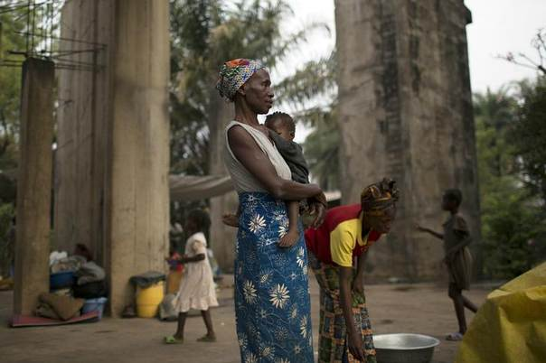 A woman stands in an unfinished church used to shelter internally displaced persons (IDPs) in Wango, a district of the capital Bangui, Central African Republic, January 26, 2014. REUTERS/Siegfried Modola