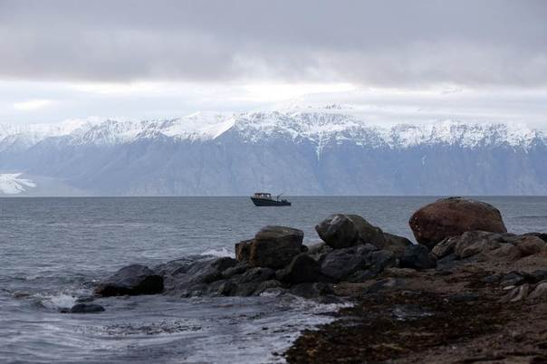 A fishing boat is seen near the Arctic community of Pond Inlet, Nunavut, Aug. 23, 2014. REUTERS/Chris Wattie