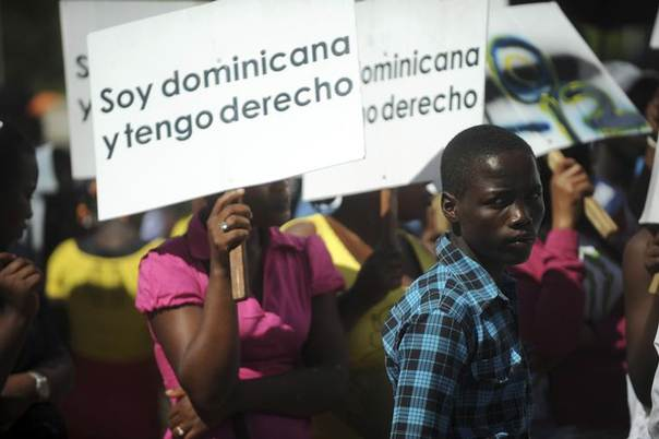 Hundreds of Dominicans of Haitian origin protest to reclaim their right to their Dominican nationality and to denounce their situation after a 2013 verdict by the Constitutional Tribunal outside the National Congress in Santo Domingo, March 12, 2014.  REUTERS/Ricardo Rojas