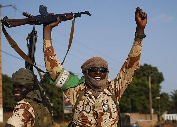 Chadian soldiers wave their guns as they drive in Bangui April 4, 2014.  REUTERS/Goran Tomasevic
