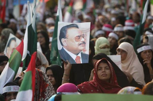A supporter of Pakistan's Muttahida Quami Movement (MQM) political party holds a poster with a picture of their leader Altaf Hussain during a rally along with others to demonstrate solidarity with their leader in Karachi February 2, 2014 REUTERS/Akhtar Soomro