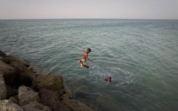 Children play in the waters off Kish Island, 1,250 km (777 miles) south of Tehran, Iran, April 27, 2011. REUTERS/Caren Firouz