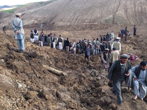 IOM staff and local villagers at the scene of a devastating earthquake in Badakhshan province, northern Afghanistan May 2, 2014./IOM