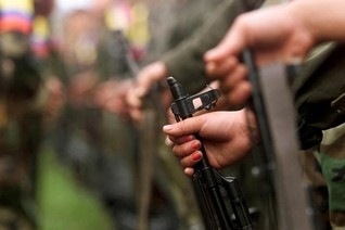 Colombia's FARC rebels turn in weapons, end armed war with government