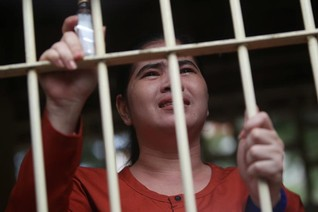 Cambodia jails land rights activist for 2-1/2 years