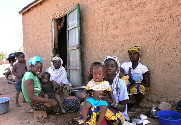 Kadia Samake sits outside her home with some of her family members in Gwelekoro village, southern Mali. TRF/Soumaila Diarra