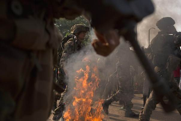 French peacekeeping soldiers try to control a crowd who have barricaded a street in the capital Bangui, Central African Republic, January 22, 2014. REUTERS/Siegfried Modola