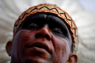 An indigenous man protests against an opinion of the General Advocacy of the Union about the demarcation of lands in Brasilia