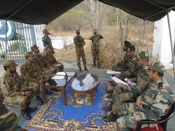 Army officers from India (R) and Pakistan are seen during their flag meeting at Chakan da Bagh in Poonch district, northwest of Jammu, India, January 14, 2013. REUTERS/Indian Ministry of Defence/Handout