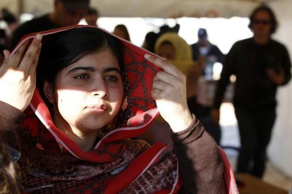 Pakistani teenage activist Malala Yousafzai, an advocate for education for girls, is seen here leaving a news conference at the Zaatri camp for Syrian refugees in Jordan. Picture February 18, 2014. REUTERS/Muhammad Hamed
