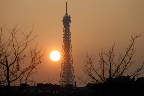 The Eiffel tower in Paris is pictured during sunset  on March 14, 2014. REUTERS/Charles Platiau