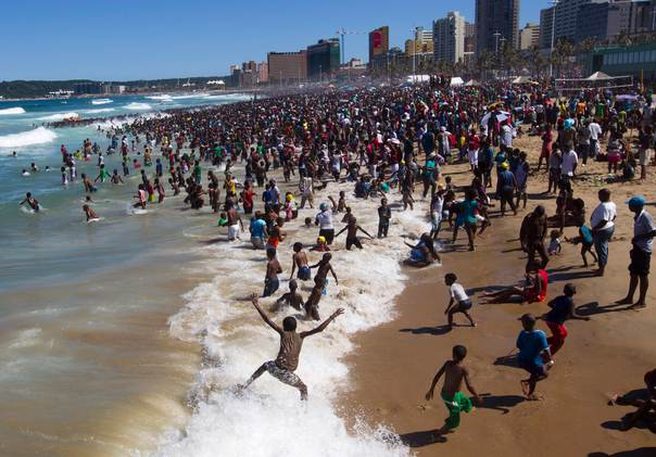 People visit the beach on New Year's Day in Durban, South Africa, on January 1, 2014. REUTERS/Rogan Ward