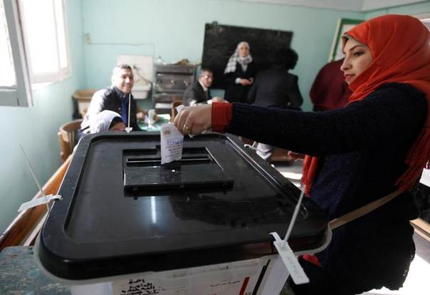 Women cast their votes at a polling centre during a referendum on Egypt's new constitution in Cairo January 14, 2014. REUTERS/Mohamed Abd El Ghany