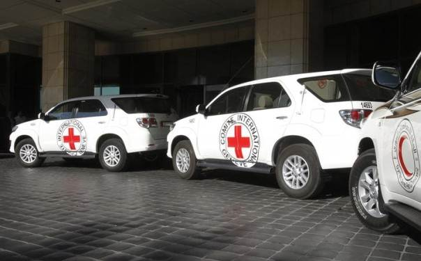 In this 2012 file photo, vehicles wait to transport Peter Maurer, president of the International Committee of the Red Cross (ICRC), for a meeting with Syria's President Bashar al-Assad in Damascus REUTERS/Khaled al-Hariri