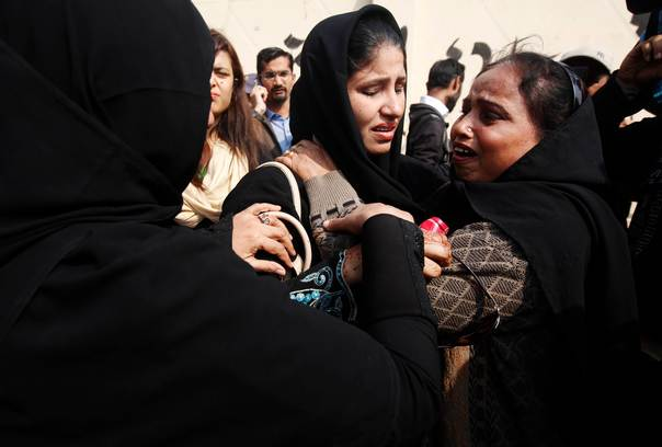 Relatives of a female polio vaccination worker, who was killed by
