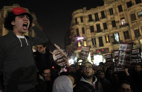 Demonstrators from 6 April movement, Ultras and anti-military groups shout slogans during a protest against government military rules and against Egypt's Army Chief General Abdel Fattah al-Sisi, at Talaat Harab square in downtown Cairo, January 22, 2014.   REUTERS/Amr Abdallah Dalsh