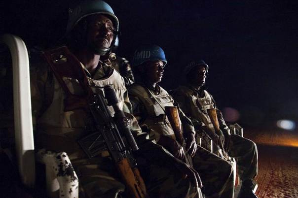 UNAMID peacekeepers from Ethiopia prepare to go on a night patrol on a pick-up vehicle, in Gereida (South Darfur), July 25, 2012.  REUTERS/Albert Gonzalez Farran/UNAMID/Handout