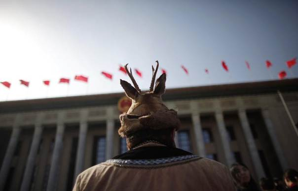 An ethnic minority delegate wearing traditional costume walks towards the Great Hall of the People, ahead of the opening ceremony of the Chinese People's Political Consultative Conference (CPPCC), in Beijing, Mar. 3, 2013. REUTERS/Carlos Barria